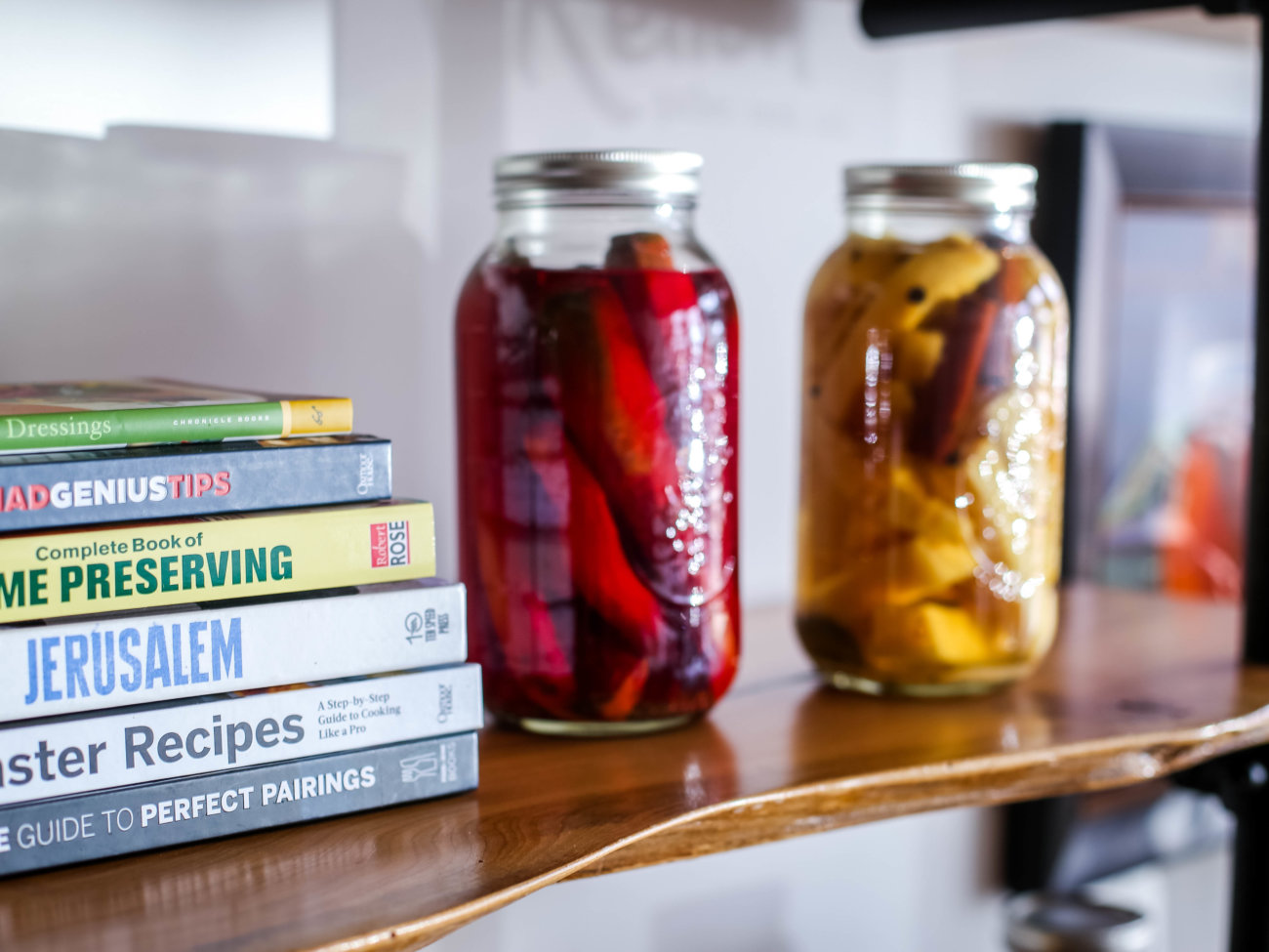 Cookbooks and canned vegetables in jars